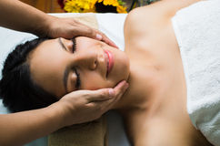 Hispanic brunette model getting massage spa Royalty Free Stock Image
