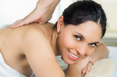 Hispanic brunette model getting massage spa Stock Photography