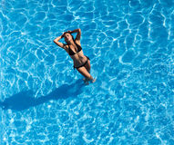 Hispanic Brunette Model At The Pool Stock Photography