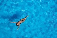 Hispanic Brunette Model At The Pool Royalty Free Stock Photos