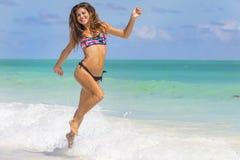 Hispanic Brunette Model Running At The Beach Royalty Free Stock Photography