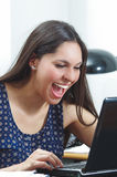 Hispanic brunette office woman sitting by desk and Royalty Free Stock Photo