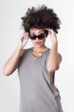 Hispanic brunette rebel model with afro like hair stock image