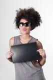 Hispanic brunette rebel model with afro like hair Royalty Free Stock Photo