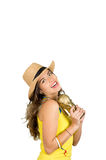 Hispanic brunette wearing yellow football shirt and hat, posing for camera while holding trophy, white studio background Stock Photos