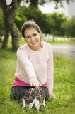 Hispanic brunette wearing yoga clothing sitting on Stock Photography