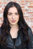 Hispanic Brunette Woman in Black Leather Jacket royalty free stock photos