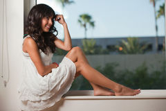Hispanic brunette woman relaxing Stock Photo
