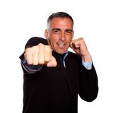 Hispanic business man boxing Stock Image