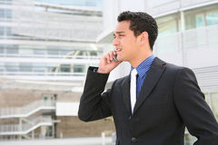Hispanic Business Man on Cell Phone Stock Images