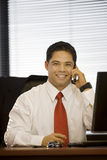Hispanic Business Man On Cellphone Royalty Free Stock Photos