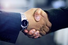 Hispanic business man shaking hands stock image