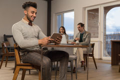 Hispanic Business Man Using Tablet Computer Businesspeople In Coworking Center Cafe Coffee Break Stock Images