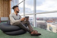 Hispanic Business Man Using Tablet Computer Sit n Front Panoramic Window Happy Smiling Businessman Stock Image