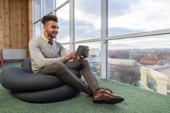 Hispanic Business Man Using Tablet Computer Sit n Front Panoramic Window Happy Smiling Businessman Stock Photos