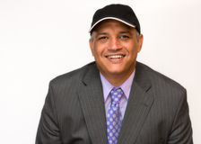 Hispanic business man. White collar employee smiling and wearing a suit over a white background. Stock Photo