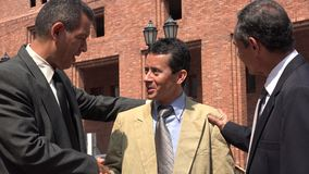 Hispanic Business Men Shaking Hands. Older business men or executives royalty free stock photos