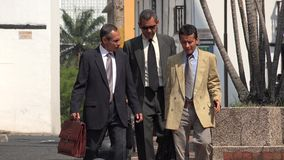 Hispanic Business Men Walking. Stock photo of business people Royalty Free Stock Image