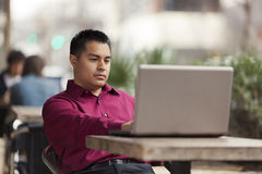 Hispanic Businessman - Cafe Laptop Working Royalty Free Stock Images