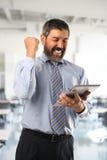 Hispanic Businessman Celebrating Stock Images