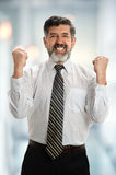 Hispanic Businessman Celebrating in Office Stock Photography