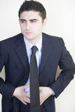 Businessman with stomachache Stock Photography