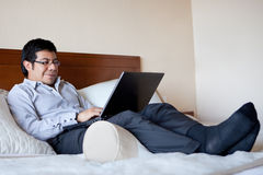 Hispanic businessman in his hotel room Royalty Free Stock Photos