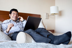 Hispanic businessman in his hotel room stock photos