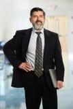 Hispanic Businessman with Laptop Royalty Free Stock Images