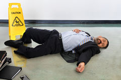 Businessman Laying Injured on the Floor royalty free stock photo