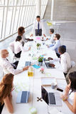 Hispanic Businessman Leading Meeting At Boardroom Table Royalty Free Stock Images