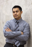 Hispanic Businessman - Leaning against wall Royalty Free Stock Photo