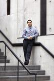 Hispanic Businessman - Leaning On Stair Rail Royalty Free Stock Photos