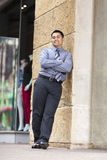 Hispanic Businessman - Leaning on stone wall Stock Photos