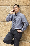 Hispanic Businessman - Leaning on Wall Stock Images