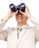 Hispanic businessman looking through binoculars Stock Image