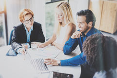 Hispanic businessman making business presentation of startup project in meeting room.Four young entrepreneurs working Royalty Free Stock Photos