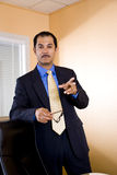 Hispanic businessman making a point Royalty Free Stock Photos