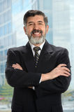 Hispanic Businessman Near Window Royalty Free Stock Photography