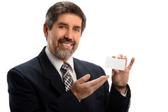 Hispanic Businessman Pointing to Blank Card Stock Photos