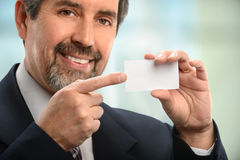 Hispanic Businessman Pointing to Card Royalty Free Stock Photography