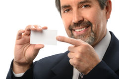 Hispanic Businessman Pointing to Card Stock Photography