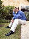 Hispanic businessman sitting Stock Photo