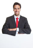 Hispanic businessman with suit and white board Royalty Free Stock Photos