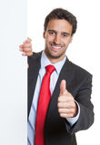Hispanic businessman with suit and white board showing thumb up Stock Images