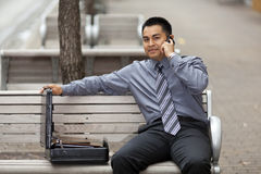 Hispanic Businessman - Talking on Cell Phone Royalty Free Stock Photos