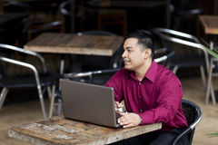 Hispanic Businessman - Telecommuting Internet Cafe Royalty Free Stock Image