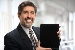 Hispanic Businessman Using Electronic Tablet Stock Image