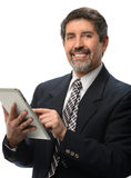 Hispanic Businessman Using Electronic Tablet Royalty Free Stock Image
