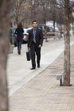 Hispanic Businessman - Walking With Briefcase Royalty Free Stock Photo
